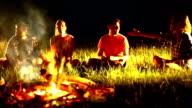 Friends having fun by campfire. video