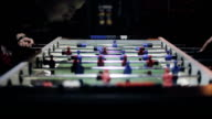 Friends having fun together playing table football video