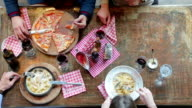 Friends having lunch in pizzeria video