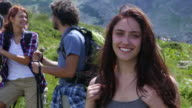 Friends hiking during the summer vacations video