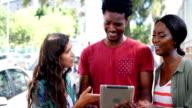 Friends interacting using digital tablet video