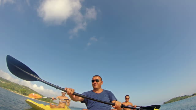 Friends kayak at sea, summer vacation adventure video