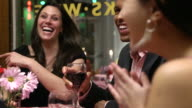 Friends Laugh Together at Restaurant video