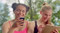 Friends laughing. Multiracial women smiling together. Close up of happy faces video