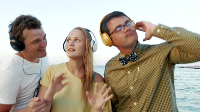 Friends Listening to the Music in Headphones video