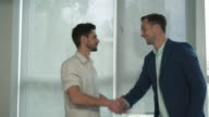 Friends meeting at the office near the window video