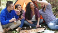 Friends on picnic eating pizza video