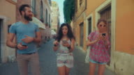 Friends playing augmented reality mobile game in Rome video