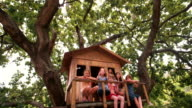 Friends playing in a treehouse and blowing bubbles video
