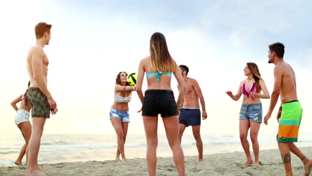 Friends playing volley on the beach video