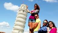 Friends pushing the Pisa tower straight video