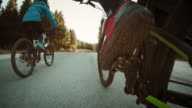 POV Friends riding bikes through countryside video