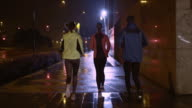 TS Friends running in the city on a rainy night video