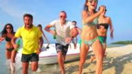 Friends running on the beach 4K video