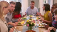 Friends Sitting Around Table At Dinner Party Shot On R3D video