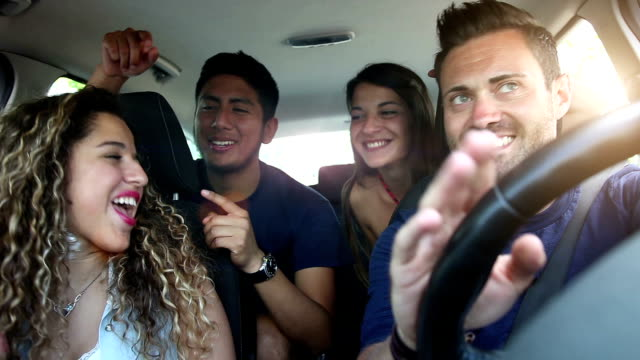 Friends sitting in the car ready to start vacations video