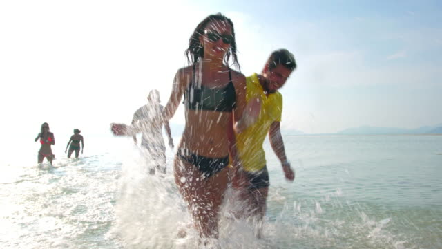 Friends splashing in the sea 4K video