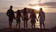 Friends Standing On Cliff Watching Sunset Shot On R3D video