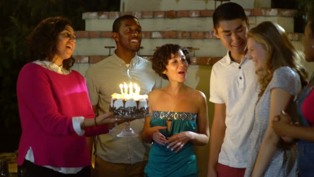 Friends surprising their friend with a birthday cake video