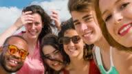 Friends taking a selfie on the beach video