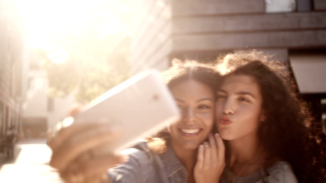 Friends Taking A Selfie With Smartphone In Urban Area video
