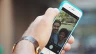 Friends taking selfie in urban location video