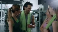 Friends talking in gym video