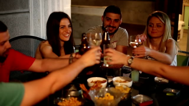 Friends toasting at party two from two angels video