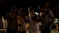Friends toasting with coffee cups in night street video