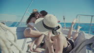 Friends together on a yacht cruising the sea video