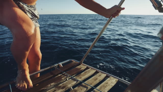 Friends together on a yacht sailboat cruising the sea video
