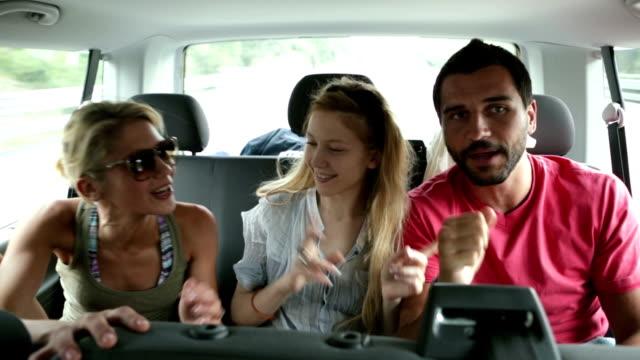 Friends traveling singing in van video HD video