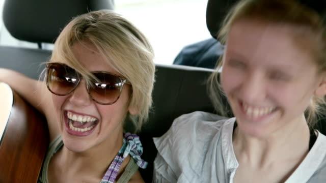 Friends traveling singing with guitar in van video HD video