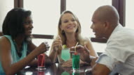 Friends: Two women and man having fun in pub video