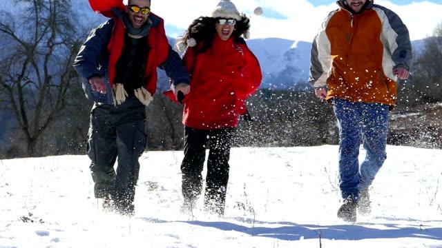 Friends walking in snow mountain- slowmotion video