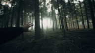 POV Frightened man running in the forest video