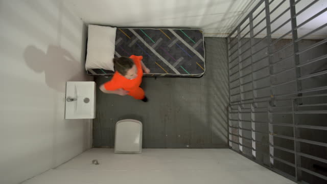 4K from above: Female Prisoner in Jail Cell Pacing the floor video