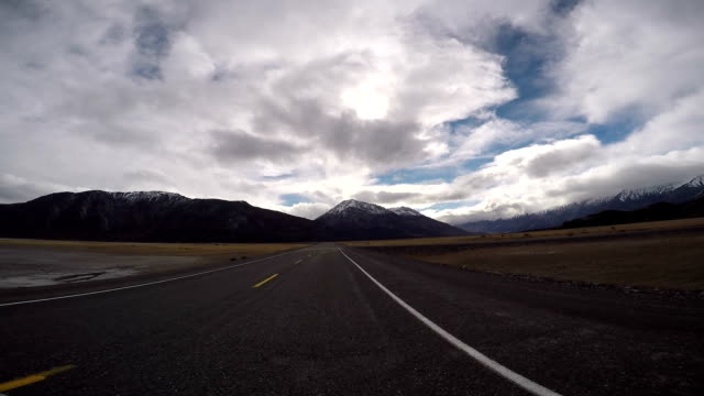 POV from car as it dives along mountain lake road video