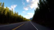 POV from car as it dives along mountain road video