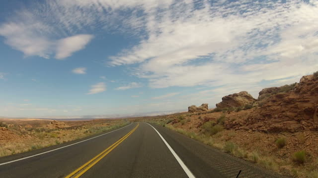 POV from car as it drives along desert road video