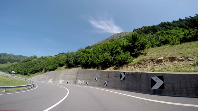 POV from car as it drives along mountain road video