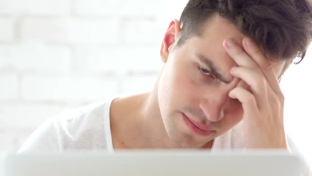 Front Close-Up of Man with Headache Working on Laptop, Pain video
