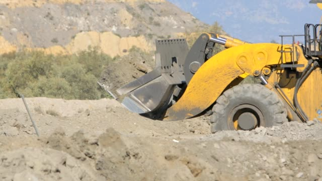 Front End Loader moving earth on a mine video