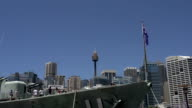 Front of a big marine ship with the Australian flag with the Sydney tower and skyline at the background video