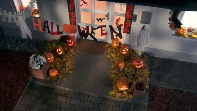 HD CRANE: Front Stoop With Halloween Decorations video