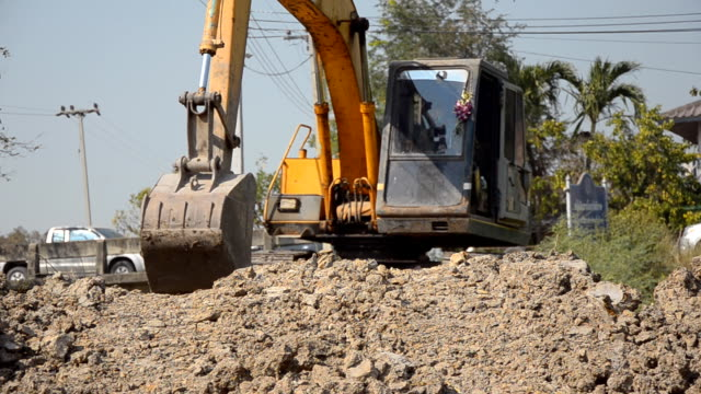 front view : Bulldozer move and dig video