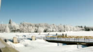 Frozen lake in the city with frost-covered trees video
