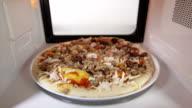 Frozen seafood pizza Frutti di Mare in microwave oven video