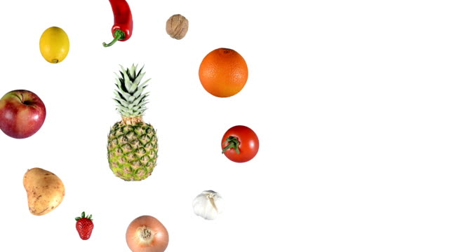 Fruits and vegetables rotating on white video