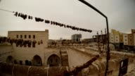 Fruits Dry on Ropes on Background Old Stone Town Urfa video